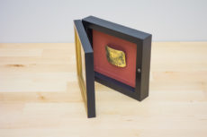 vintage belt buckle in hinged frame