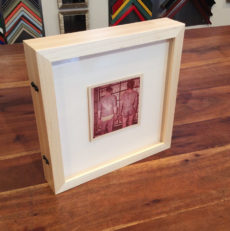 vintage photographs in double-sided frame